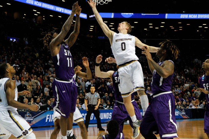 Freshman guard Rex Pflueger scores on a tip-in with 1.5 seconds left to lead Notre Dame past Stephen F. Austin, 76-75, at Barclays Center on Sunday.