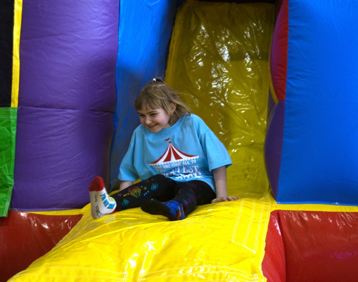 A girl plays on an inflatable slide as part of Saint Mary's annual 12 hour Dance Marathon that supports Riley Hospital for Children.