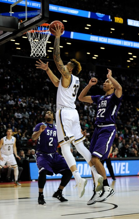 Irish senior forward Zach Auguste scores a layup during Notre Dame's second-round win over Stephen F. Austin on Sunday in Brooklyn, N.Y.