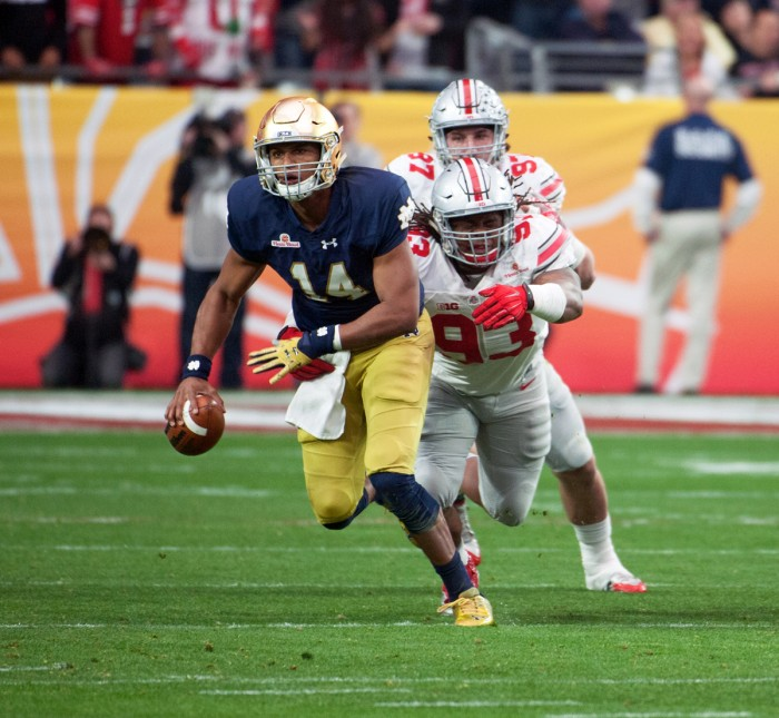 Irish junior quarterback DeShone Kizer eludes the pass rush during Notre Dame's 44-28 loss to Ohio State on Jan. 1 at University of Phoenix Stadium.