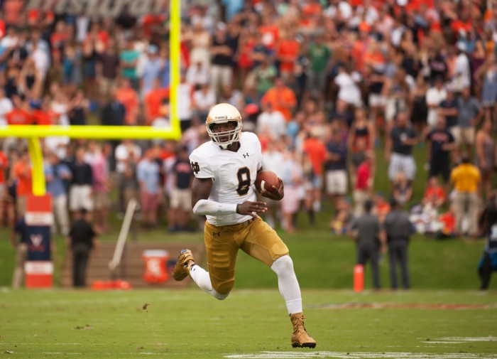 Senior quarterback Malik Zaire runs upfield during Notre Dame's 34-27 victory over Virginia in Charlottesville on Sept. 12.