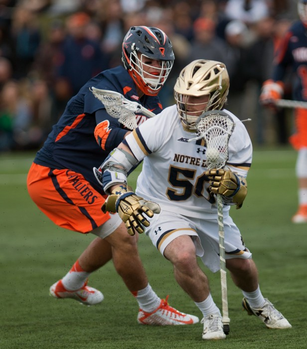 Irish senior attackman Matt Kavanagh makes a move against a Virginia defender at Arlotta Stadium Saturday. Kavanagh scored twice in the 8-7 overtime win for Notre Dame.