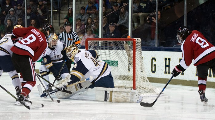 Sophomore goalie Cal Petersen attempts to save a shot during Notre Dame's 6-4 loss to Northeastern on March 12.