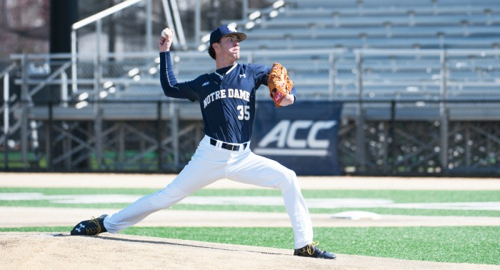 Junior pitcher Peter Solomon delivers a pitch during Notre Dame's 10-2 victory over Wake Forest on Sunday at Frank Eck Stadium.