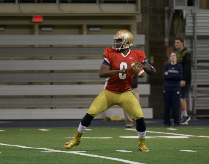 Senior quarterback Malik Zaire drops back to pass during a practice on Tuesday morning at Loftus Sports Center.