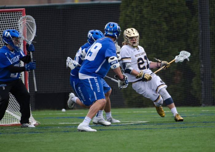 Irish freshman attack Ryder Garnsey fights for a shooting angle during Notre Dame's 8-6 win over Duke on April 10 at Arlotta Stadium.