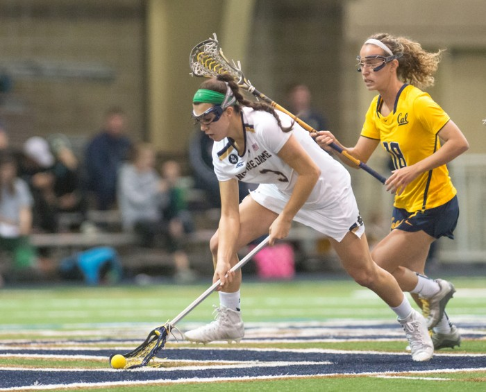 Freshman attack Nikki Ortega fends off defenders during Notre Dame's 21-2 victory over California on Feb. 28 at Arlotta Stadium. Ortega had two shots in the Irish loss to Northwestern on Sunday.