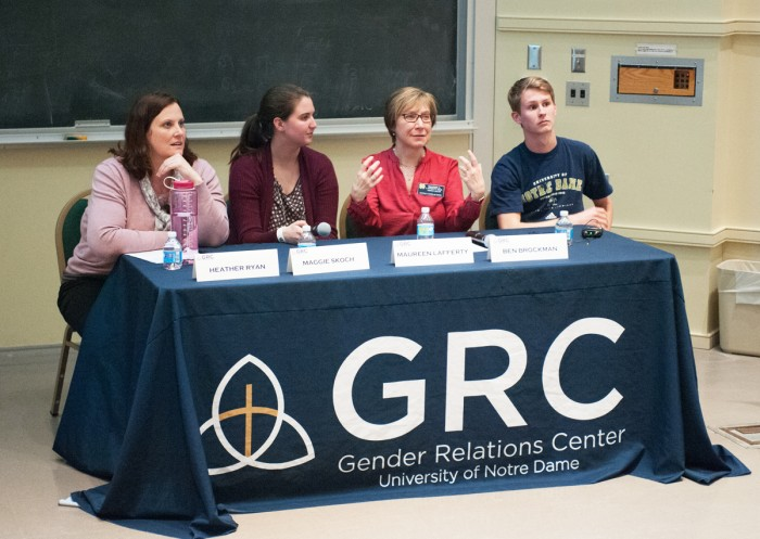 Panelists gather in DeBartolo Hall on Wednesday night to teach students how to identify and cope with unhealthy relationships. The speakers confronted issues such as stalking and emotional abuse.