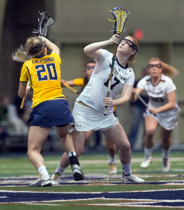 Irish graduate student defender Barbara Sullivan tries to win the draw during Notre Dame's 21-2 victory over California on Feb. 28.