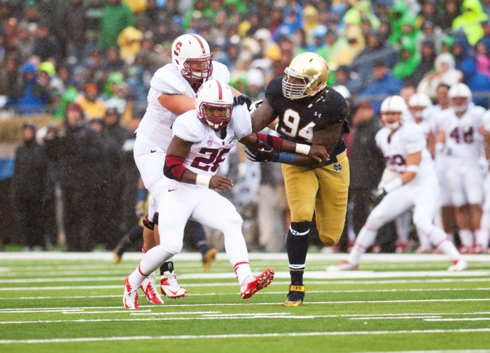 Graduate student defensive lineman Jarron Jones tries to evade blockers during Notre Dame's 17-14 win over Stanford on Oct. 4, 2014.