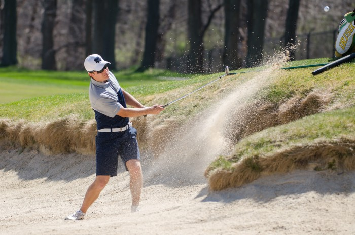 Irish sophomore Jens Verhey hits the ball out of the bunker during Notre Dame's first place finish at the Battle at the Warren Invitational at the Warren Golf Course on April 16.