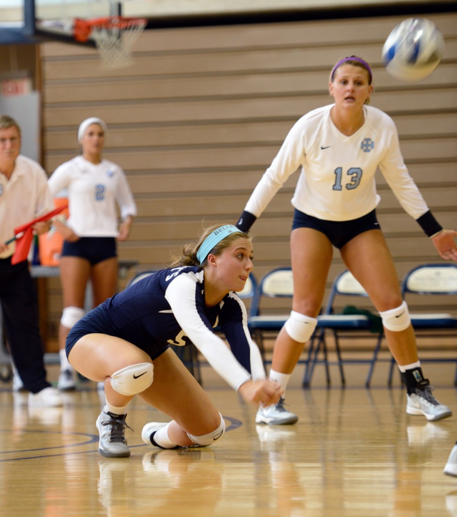 SMC senior defensive specialist Angela Bukur lunges for the ball in the Belles' win over Manchester on Sept. 1 at Angela Athletic Facility.