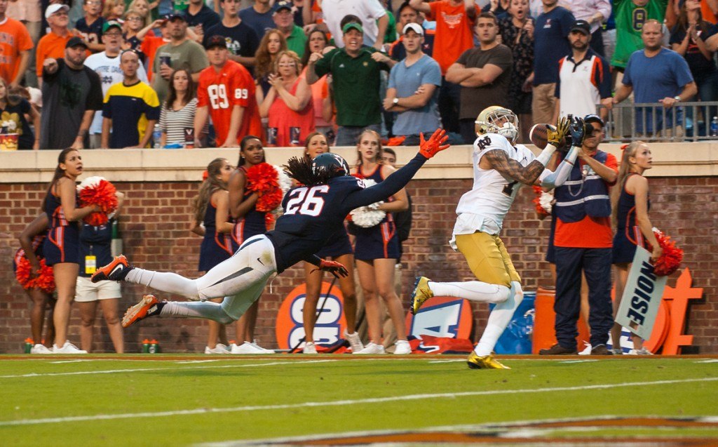 Former Irish receiver Will Fuller hauls in the game-winning touchdown reception over a defender during Notre Dame's 34-27 win over Virginia on Sept. 12. Fuller was selected 21st overall in the NFL Draft.