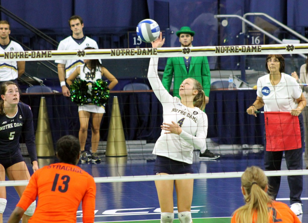 Irish freshman libero Ryann DeJarld tips the ball back over the net in Notre Dame's 3-2 loss to Syracuse at Purcell Pavilion.