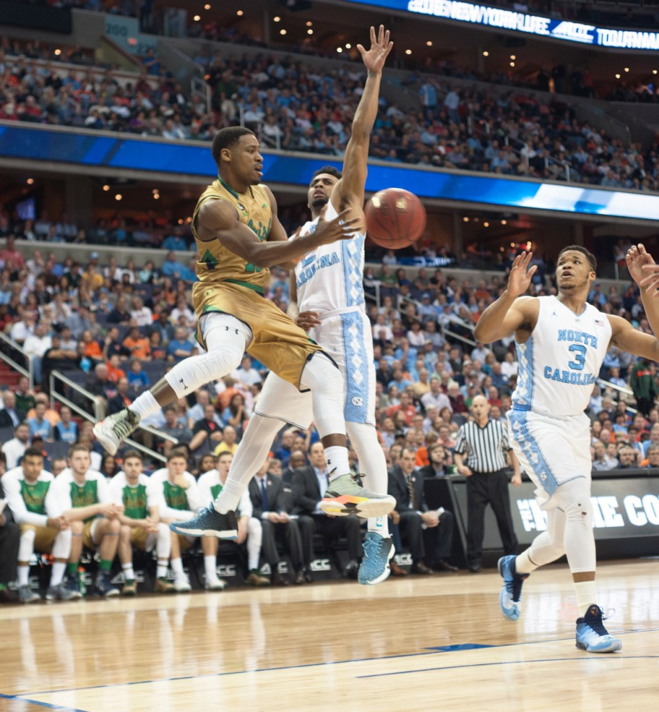 Former Irish junior guard Demetrius Jackson dishes out a pass around a defender during Notre Dame's 78-47 loss to North Carolina on March 11 at the Verizon Center. Jackson has declared for the NBA Draft.