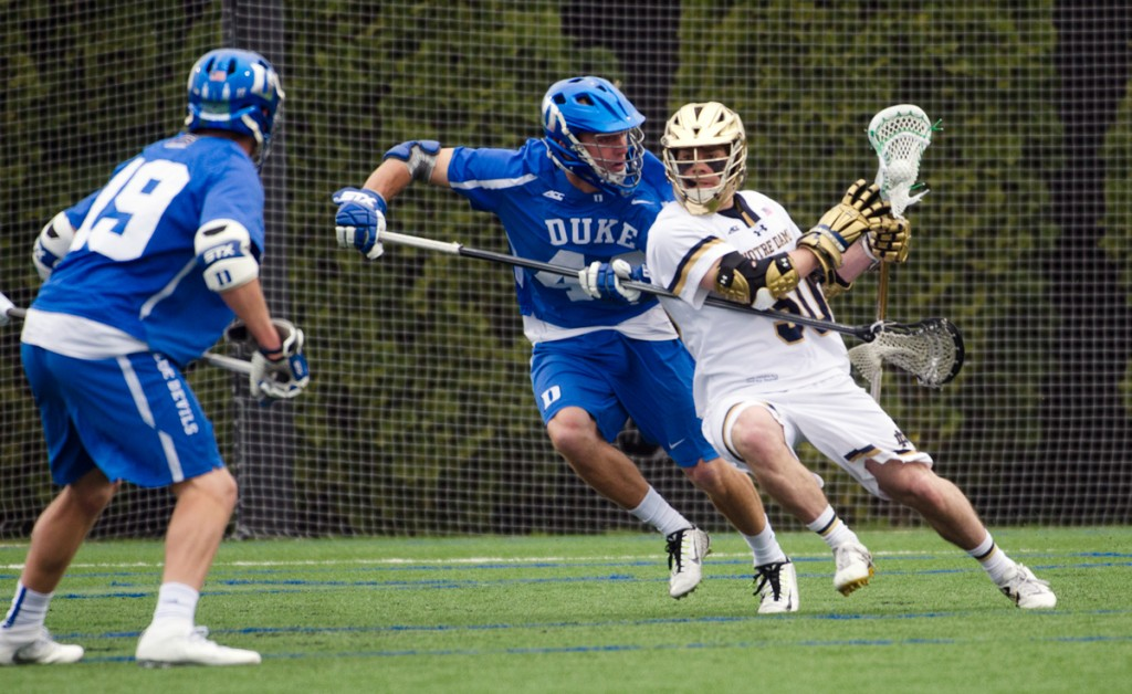 Irish senior attack Matt Kavanagh maneuvers around defenders during Notre Dame's 8-6 win over Duke on April 10 at Arlotta Stadium. Kavanagh was named a Tewaaraton Award nominee on April 29.