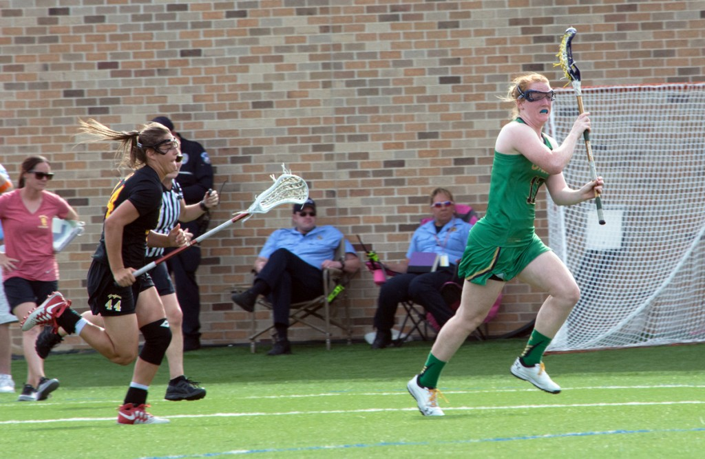 Irish graduate student defender Barbara Sullivan carries the ball upfield during Notre Dame's 5-4 loss to USC on April 18.