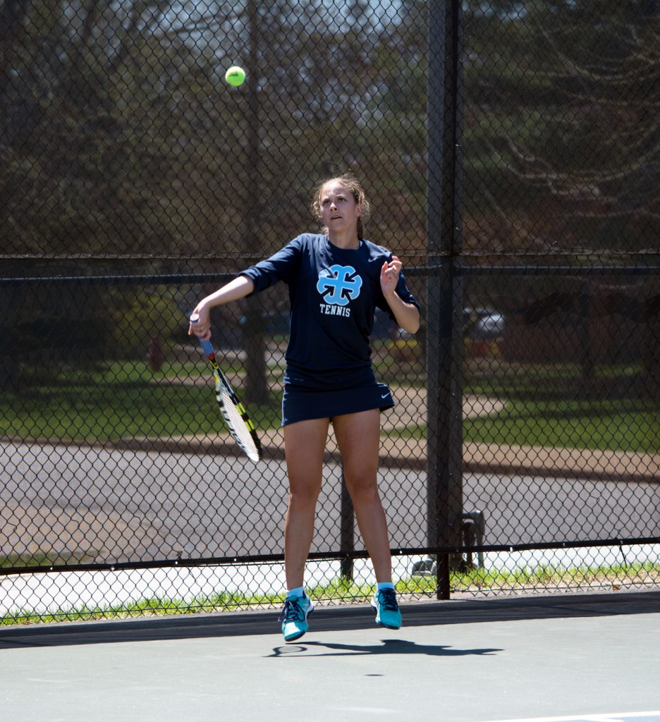 SMC senior captain Andrea Fetters hits a forehand in Saint Mary's' 9-0 shutout of Concordia (Mich.) on April 23 at Angela Tennis Courts.