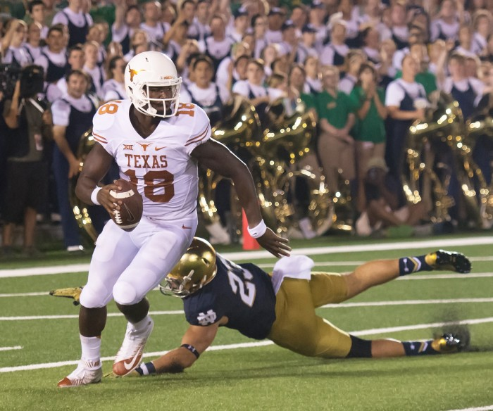 Longhorns senior quarterback Tyrone Swoopes evades Irish junior safety Drue Tranquill during last year's 38-3 Irish home win Sept. 5.