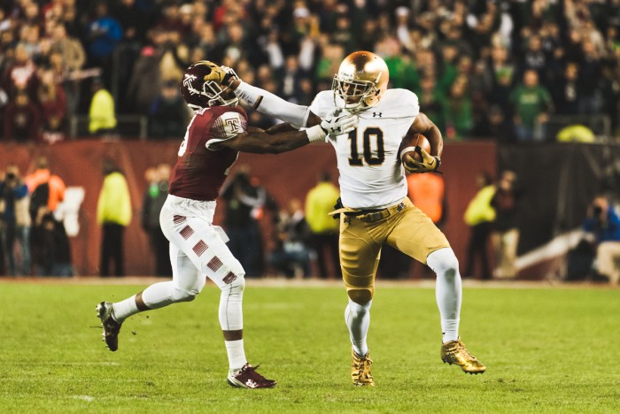 Irish sophomore tight end Alizé Jones stiff arms Temple defensive back Nate L. Smith on a 45-yard gain during Notre Dame's game-winning drive in last season's 24-20 victory over Temple at Philadelphia's Lincoln Financial Field. It was Jones' only reception of the night, but it put the Irish in position to win the game from the red zone.
