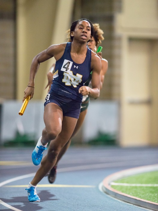 Former Irish sprinter Margaret Bamgbose races around the turn in the 4x400-meter relay on Jan. 24, 2015 at Loftus Sports Center.