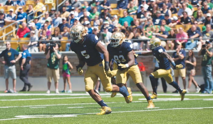 Irish junior linebacker Nyles Morgan, 5, looks to make a play during the Blue-Gold Game on April 17 at Notre Dame Stadium.