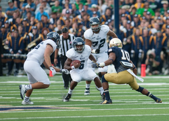 Irish senior safety Max Redfield prepares to tackle the ballcarrier in Notre Dame's 48-17 win over Rice on Aug. 30, 2014. Redfield was dismissed from the team Sunday following his arrest late Friday night.
