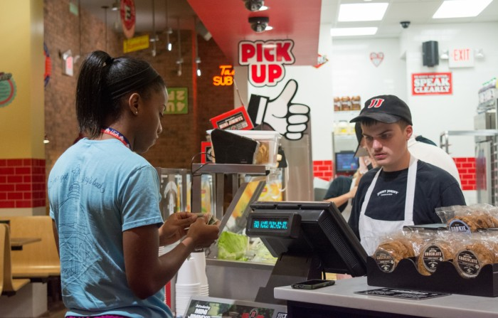 Notre Dame senior Lindsay Allen orders dinner at the new Jimmy John's location on Eddy Street on Sunday. The restaurant joins other chains such as Chipotle and Five Guys.