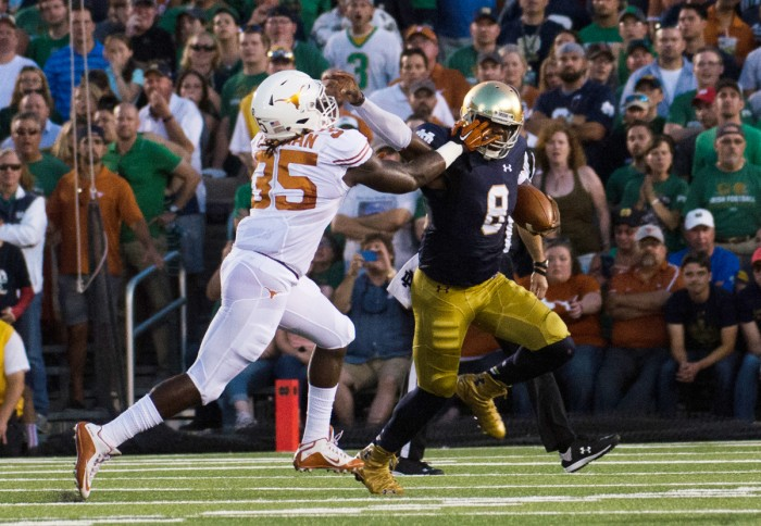 Irish senior Malik Zaire stiff arms a defender during Notre Dame's 38-3 victory over Texas on Sept. 5 at Notre Dame Stadium.