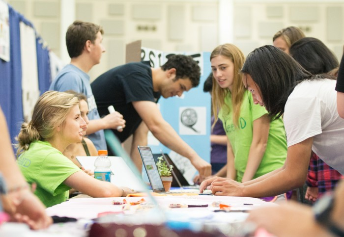 Members of GreeND recruit students at Tuesday's Activities night in the Joyce Center. Nearly 350 organizations had tables at the event, which was meant to help new students involved on campus.