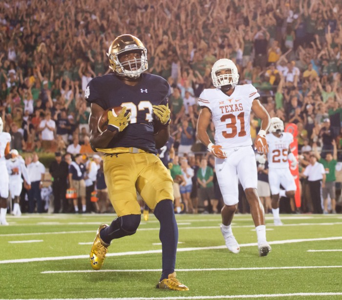 Irish sophomore running back Josh Adams crosses the goal line for a touchdown during Notre Dame's 38-3 win last season over Texas on Sept. 5. Adams rushed for two touchdowns in the game — his collegiate debut — as the Irish routed the Longhorns. Adams enters his sophomore year alongside senior Tarean Folston as a starter on the depth chart.