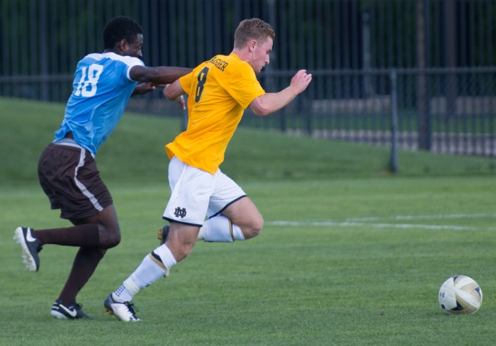 Notre Dame junior forward Jon Gallagher runs past a defender during Notre Dame's 1-1 tie with Valparaiso on August 22 at Alumni Stadium. Gallagher leads the Irish this season in points with five.