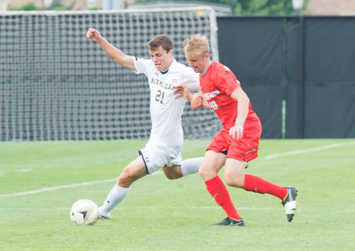 Irish sophomore midfielder Thomas Ueland attempts to dribble around a defender during Notre Dame's 1-0 win over New Mexico.