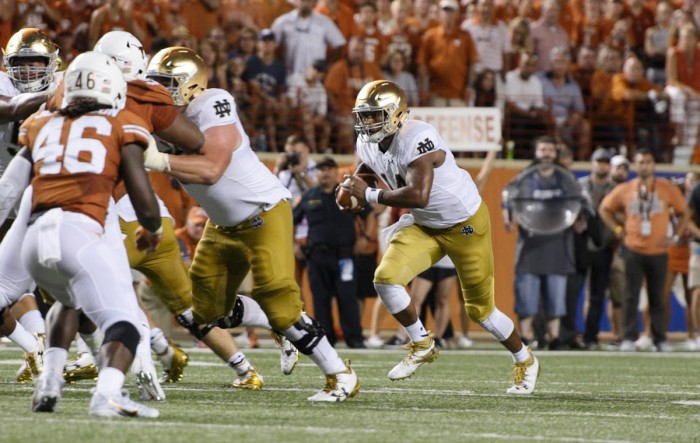 Irish junior quarterback DeShone Kizer tucks the ball and looks for a running lane during Notre Dame's 50-47 loss to Texas. Kizer had 292 total yards, including 77 on the ground, in Sunday's defeat.