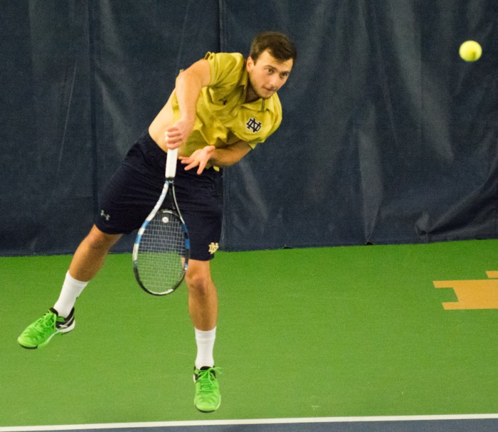 Irish senior Eddy Covalschi returns the ball during Notre Dame's 5-2 win over Duke on March 18 at Eck Tennis Pavilion.