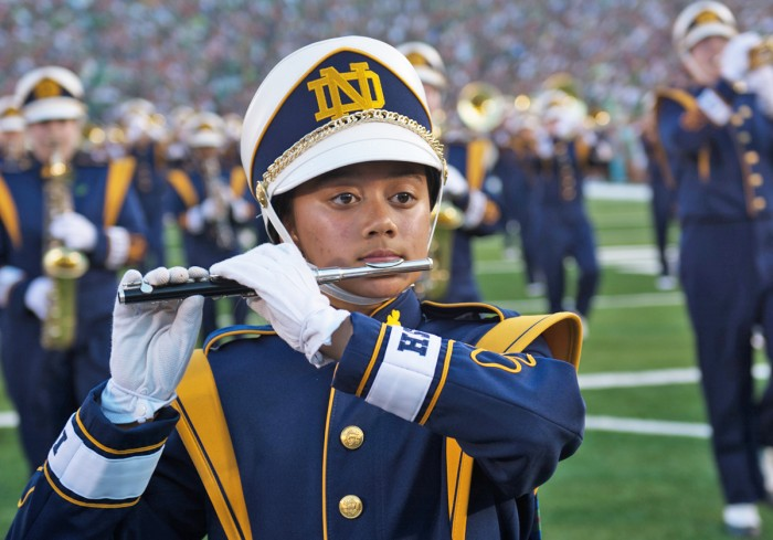 Senior Kim Forbes marches onto the field at Notre Dame Stadium. The band will relocate for the 2017 season, moving from an on-field location in the northeast corner of the stadium to the front of the student section.