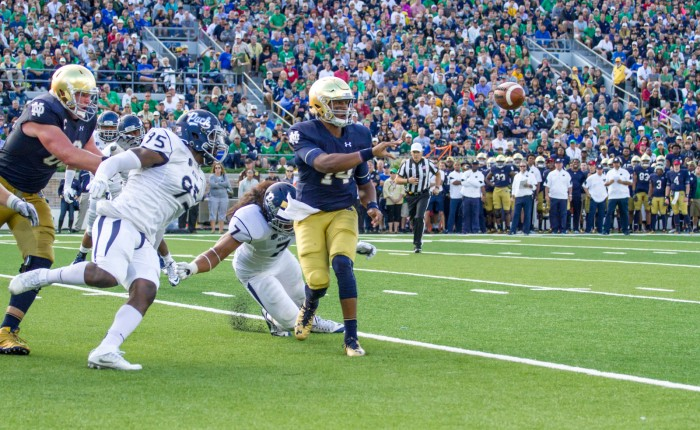 Junior quarterback DeShone Kizer pitches the ball to senior running back Tarean Folston for a touchdown during Notre Dame's 39-10 win over Nevada on Saturday.