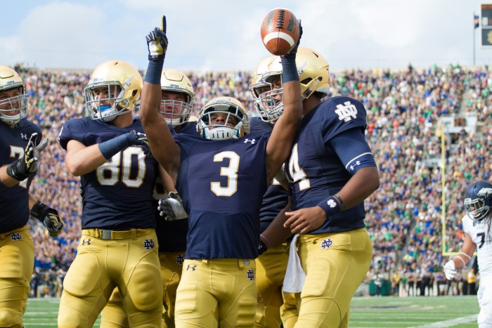 Irish sophomore receiver C.J. Sanders, center, celebrates with teammates following his touchdown Saturday in Notre Dame's 39-10 win over Nevada.