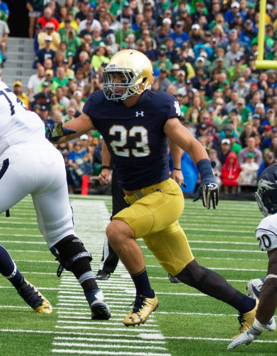 Irish junior safety Drue Tranquill rushes the quarterback in Notre Dame's 39-10 victory over Nevada on Saturday.
