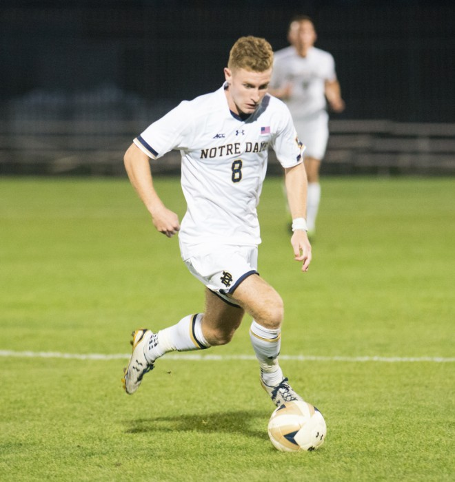 Irish junior forward Jon Gallagher maneuvers across the field in Notre Dame's 1-0 win in double overtime over Connecticut on Tuesday at Alumni Stadium. Gallagher scored the game-winning goal against the Huskies in the second overtime period.
