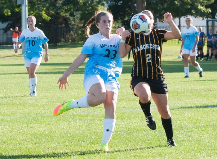 Belles freshman forward Shayleigh O'Donnell fights a defender for the ball during Saint Mary's 4-1 win over Manchester at the Purcell Athletic Fields on Sept. 2. Saint Mary's outshot Manchester 13-7 and held a 7-1 advantage in corner kicks.
