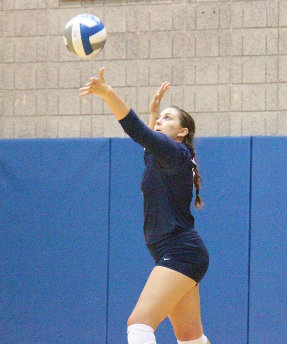 Belles sophomore defensive specialist Emily Peppers serves the ball during Saint Mary's 3-0 loss to Adrian on Sept. 9 at Angela Athletic Facility.  Belles senior outside hitter Meaghan Gibbons led all players with 13 kills on the night while registering 14 digs against Adrian.