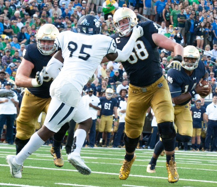 Irish senior offensive lineman and team captain Mike McGlinchey leads the way on senior running back Tarean Folston's touchdown run late in the second quarter during Notre Dame's victory over Nevada.