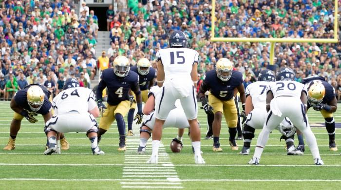 Irish linebackers sophomore Te'von Coney, 4, and junior Nyles Morgan, 5, show blitz while Nevada senior quarterback Tyler Stewart waits for the snap last weekend.
