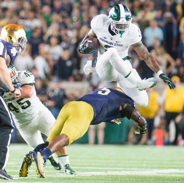 Irish junior linebacker Nyles Morgan dives to tackle the ball carrier during Notre Dame's 36-28 loss to Michigan State on Saturday.