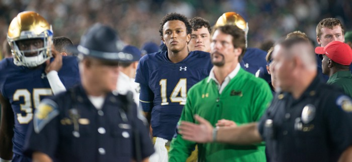 DeShone Kizer and Brian VanGorder leave the field after Notre Dame's 36-28 loss to Michigan State on Saturday.