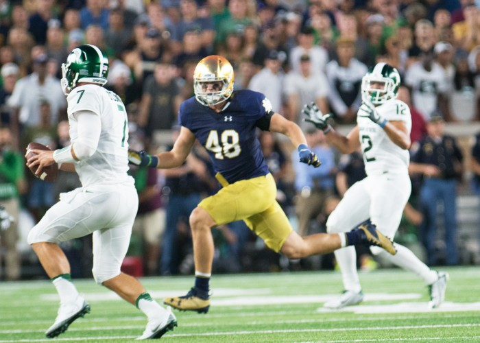 Irish junior linebacker Greer Martini chases the quarterback during Notre Dame's 36-28 loss on Saturday. Martini has 16 total tackles on the season and has shared time with sophomore Te'von Coney.