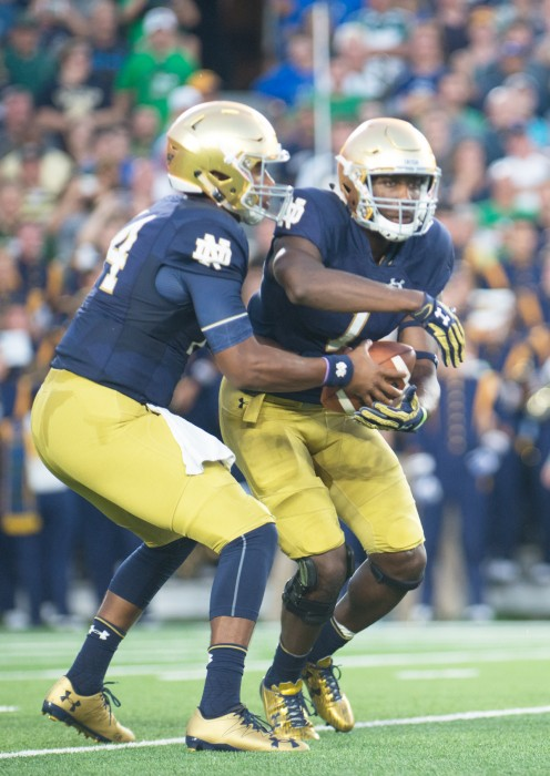 Irish sophomore running back Josh Adams receives a handoff during Notre Dame's 36-28 loss to Michigan State at Notre Dame Stadium.