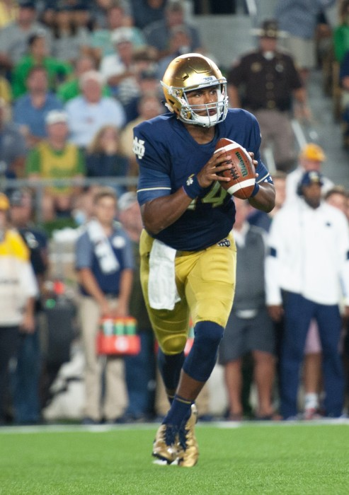 Irish junior quarterback DeShone Kizer rolls out for a pass during Notre Dame's 36-28 loss against Michigan State on Saturday.