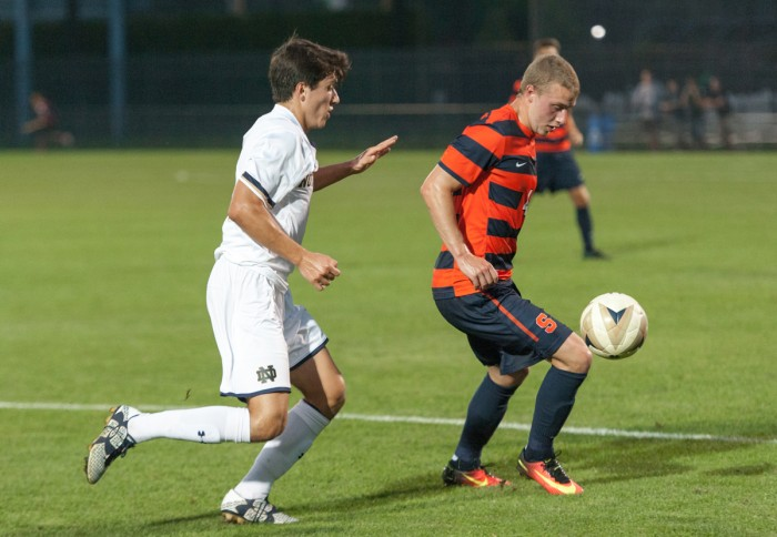 Irish freshman midfielder Jack Casey looks to attack the loose ball during Notre Dame's 2-1 win over Syracuse on Friday at Alumni Stadium. Casey scored the first goal of the game for the Irish.